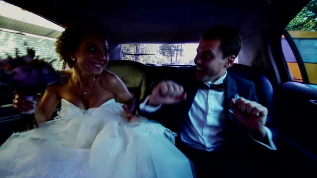 Happy Newlyweds Having Fun in a Limo video