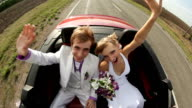 Happy newlyweds in a car video