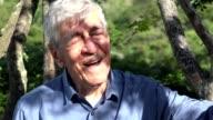 Happy Old Man Near Tree video