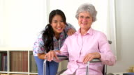 Happy patient with her Japanese caregiver video