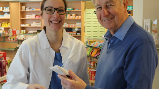 Happy Pharmacist And Senior Man In Store video