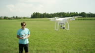 SLOW MOTION CLOSE UP: Happy pilot starts flying RC helicopter video