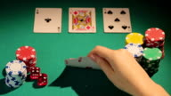 Happy poker player checking cards, showing thumbs-up hand sign, lucky video