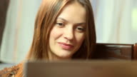 Happy pretty female making video call online, web conference video