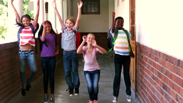 Happy pupils jumping in the air video