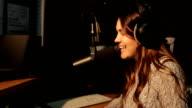 Happy Radio DJ in studio talking with audience video