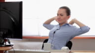 Happy relaxed businesswoman having a break at working place video