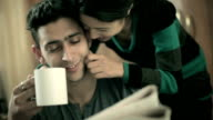 happy romantic couple reading newspaper together at coffee break. video