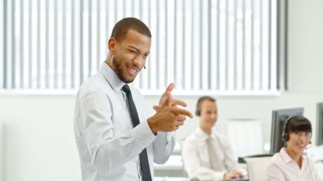 TS Happy salesman dancing after closing the deal video