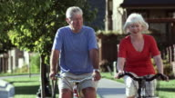 Happy senior couple bike ride video