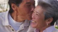 Happy senior couple, closeup video
