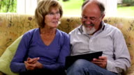 Happy Senior Couple with Digital Tablet video
