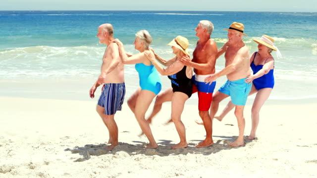 Happy senior friends dancing video