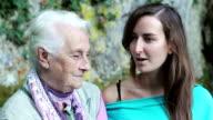 happy senior grandmother and adult granddaughter closeup portrait video