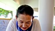 Happy Senior Japanese Woman Drinking Coffee video