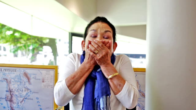 Happy Senior Japanese Woman Making Faces in a Cafe video