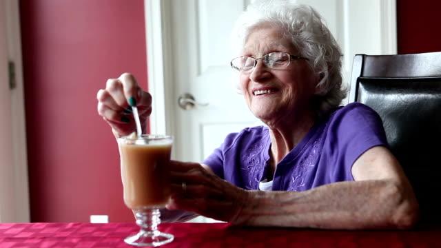 Happy Senior Woman Stirring Tea video