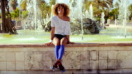 Happy Sexy Girl Sitting on Fountains Wall video