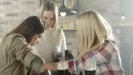 Happy shopping women in cafe video