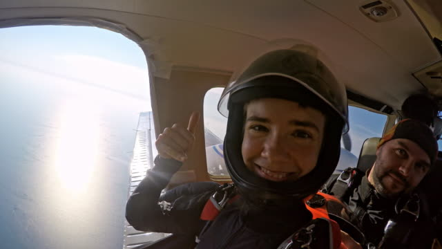 Happy skydivers on the plane video