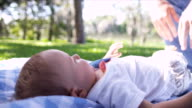 Happy Smiling Baby Playing Blanket Park Grass video