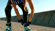 happy sporty woman wearing inline skates video
