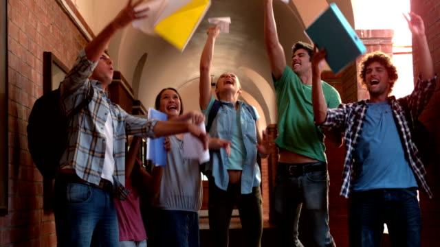 Happy students jumping in air in hallway video