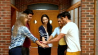 Happy students putting their hands together video