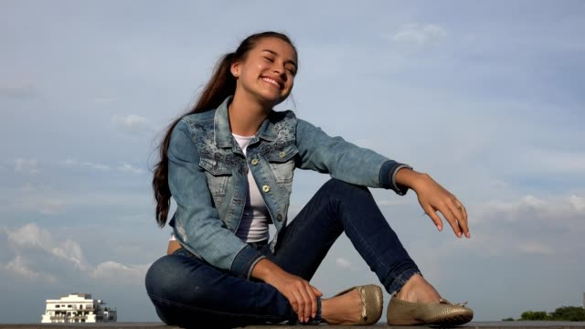 Happy Teen Girl Sitting Relaxing And Daydreaming video