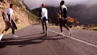 Happy teen skaters walking together and smiling video