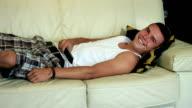 Happy teen watching tv, laughing video