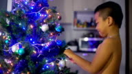 Happy Thai Boy decorates Christmas tree video
