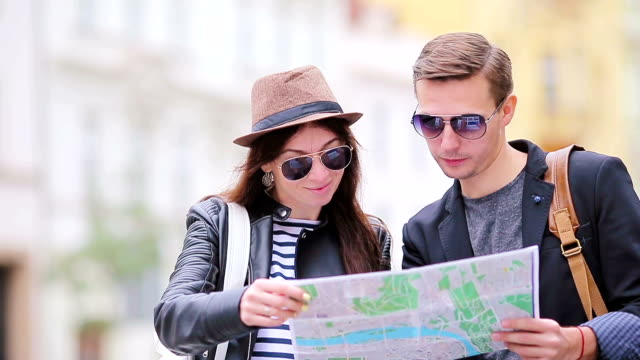 Happy tourist couple traveling on holidays in Europe smiling happy. Caucasian couple video