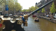 DOF: Happy tourists partying, sightseeing and riding boats in river canal video