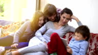 Happy Turkish Family Playing with Digital Tablet Together at Home video