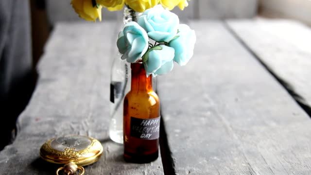 Happy Valentines Day label and nice flowers in the bottles video