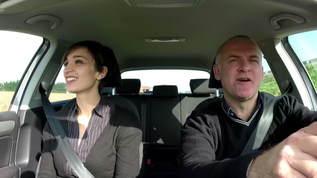 Happy White Couple Traveling By Car And Enjoying Road Trip video