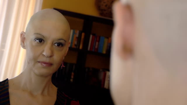 happy woman after chemotherapy wearing earrings video
