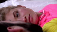 Happy woman and her husband talking in bed, closeup video