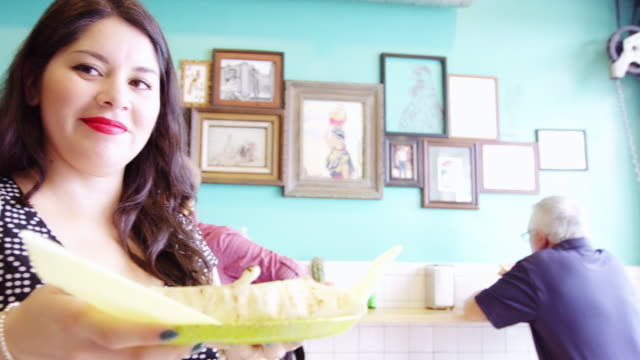 Happy Woman Collecting Food Order in Taqueria video