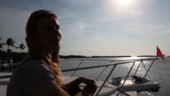 Happy woman dance-relaxing while waiting for a yacht trip video