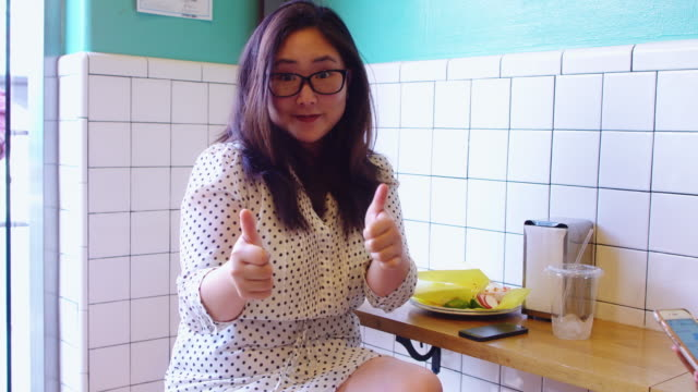 Happy Woman Eating in Restaurant video