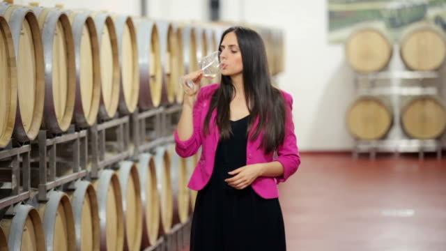 Happy woman in a wine cellar video