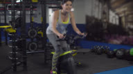 Happy woman on a spinning bike at the gym video