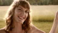 Happy woman on a swing video