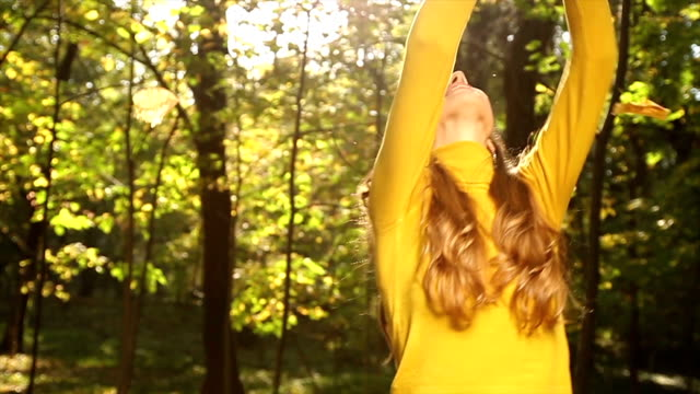 Happy Woman Playing with Autumn leaves Park Joy video
