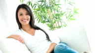 Happy woman relaxing at home video