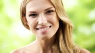 HD 1080@29,97: Happy woman touching skin or applying creme video