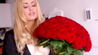 Happy Woman with Fresh Red Rose Flower Bouquet video