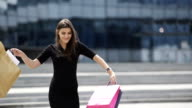 Happy woman with shopping bags video